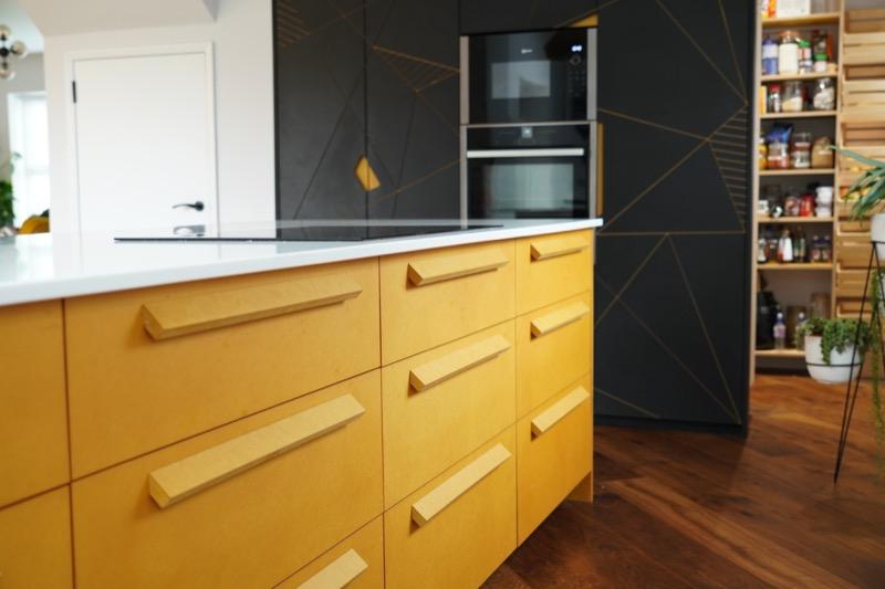 yellow and black valchromat kitchen