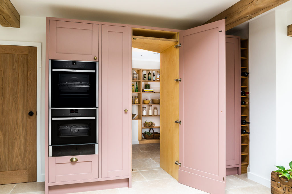 Hand painted green and pink modern shaker kitchen