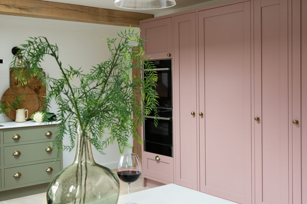 In frame pink and green kitchen