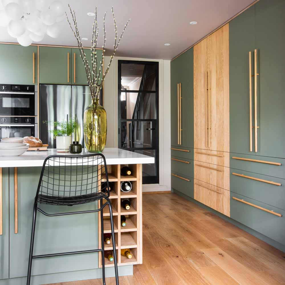 Green forbo and oak kitchen