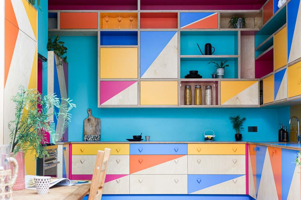 bespoke colourful kitchen , tall kitchen , high kitchen cupboards.