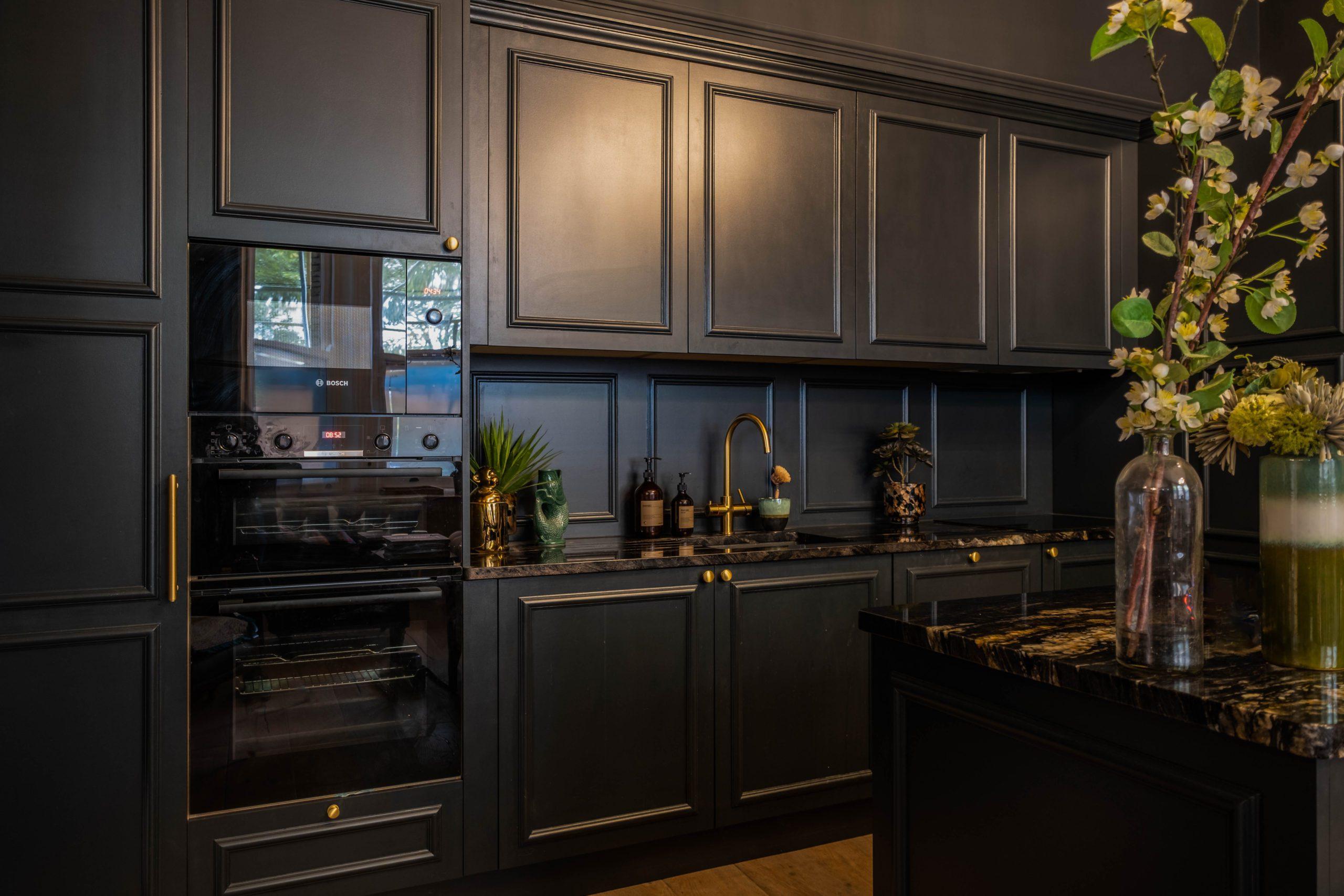 amazing dark bespoke kitchen