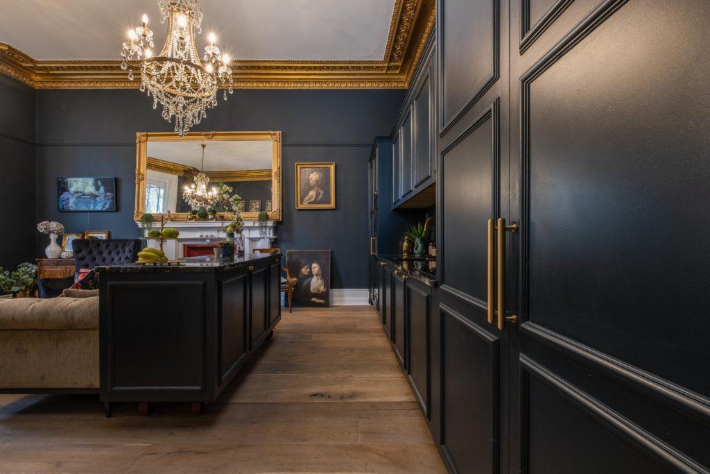 Dark panelled kitchen