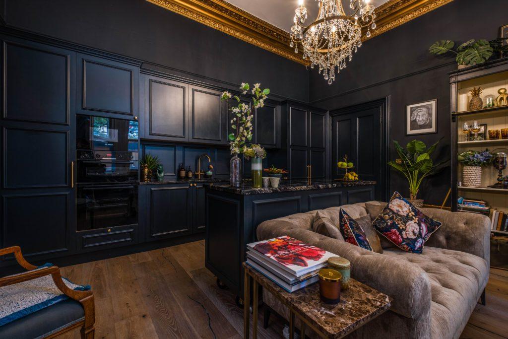 living room kitchen , Dark panelled kitchen